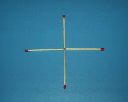 Wooden matchstick logic puzzle task geometric shape cross Banco de Imagens