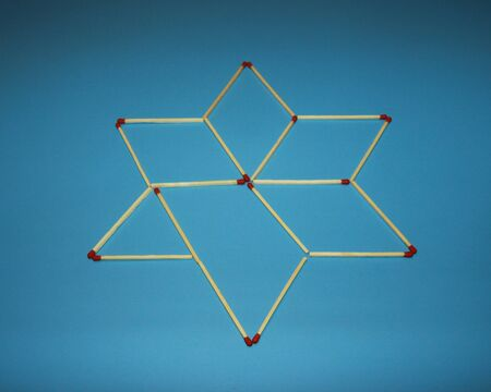 Wooden matchstick logic puzzle task geometric shape star