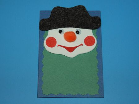 Christmas card snowman in hat with red nose made of felt handmade