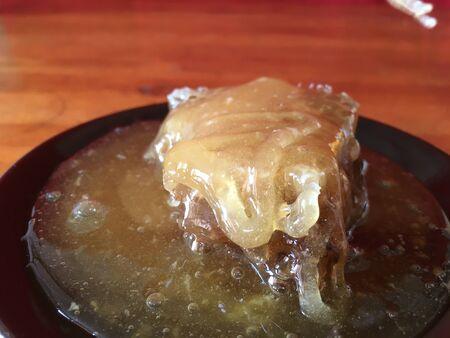 abstract hexagonal background natural fresh golden liquid honey honeycombs