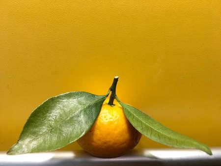vitamin tropical tangerine with leaves Фото со стока