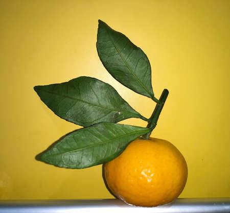 fresh orange with green leaves Фото со стока