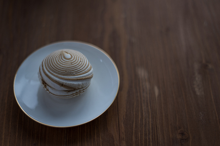 Coffee marshmallow at white porcelain plate