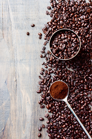 jamoke: Coffee beans over grunge wooden background. Top view.