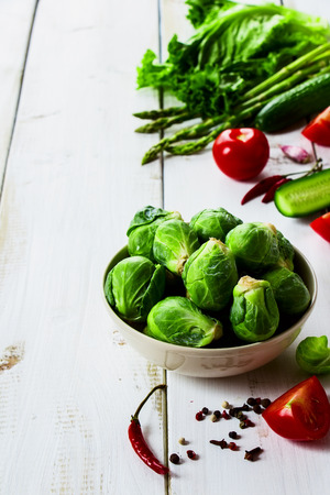 brussel: Brussel sprouts and Healthy Organic Vegetables on White Wooden Background