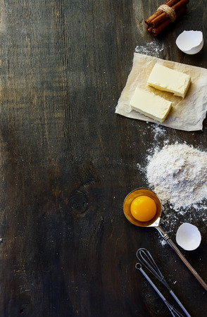 Cookies ingredients - flour, sugar, egg, butter on vintage wood table. Top view. Rustic background with free text space. Stock Photo - 46933981