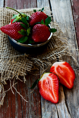 Delicious strawberries on Wooden Background. Summer or Spring Organic Berry over Wood. Agriculture, Gardening, Harvest Concept.