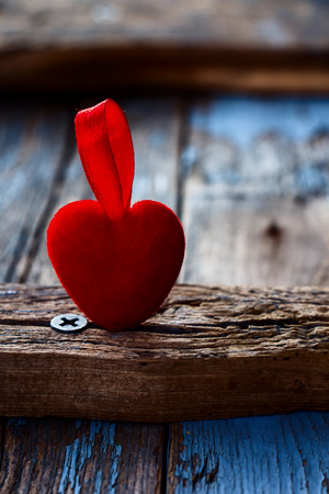 selective: Valentines day red heart over old wooden board. Selective focus.