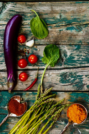 organic farm: Organic vegetables and herbs on rustic Wooden Background. Stock Photo