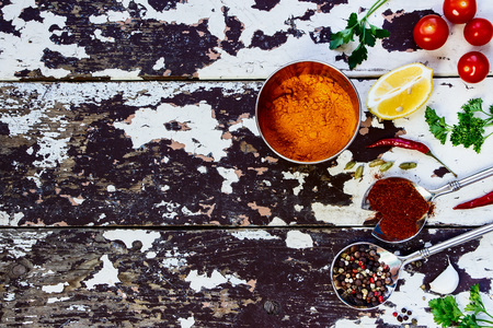 Spices and herbs selection - vintage spoons and old wooden background - cooking, healthy eating. Food concept. Top view. Foto de archivo