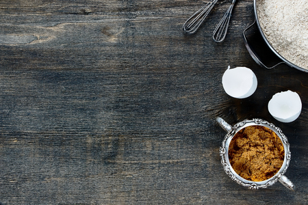 brown: Baking background with copy space - brown sugar and flour on wooden texture. Top view. Stock Photo
