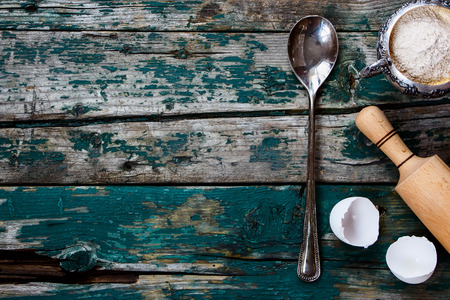 Vintage spoon and baking ingredients on old wooden background Stock Photo