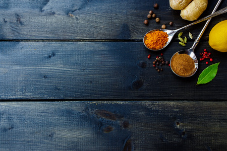 spicy: Top view of various herbs and spices selection on dark wooden table. Background with space for text.