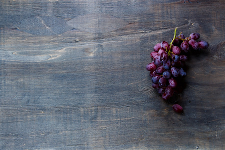 grape: Top view of bunch grapes on dark wooden table. Background with space for text. Food concept. Stock Photo
