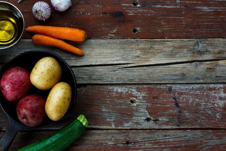 rustic food: Fresh ingredients on rustic wooden background. Vegetarian food, health or cooking concept.