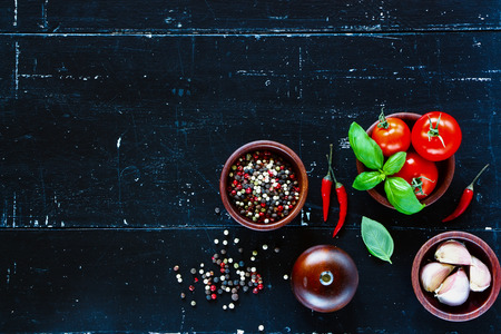 fresh: Top view of fresh vegetables, garlic and spices on dark vintage background with space for text.