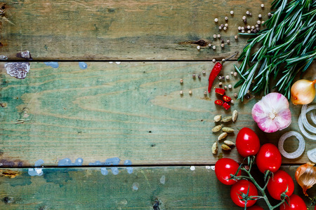 restaurant kitchen: Herbs, spices and ingredients on old wooden background with space for text. Cooking, Healthy Eating or Vegetarian concept. Top view.
