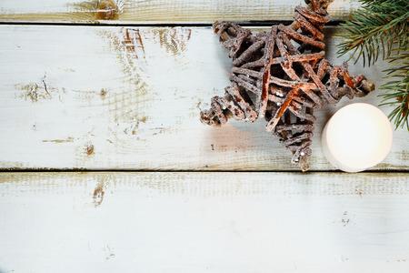decor: Rustic christmas decor on white wooden background. Stock Photo