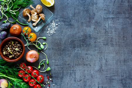 Garden vegetables with fresh ingredients for healthily cooking on vintage background, top view, banner. Stock Photo