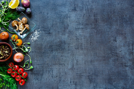 rustic food: Raw organic vegetables with fresh ingredients for healthily cooking on vintage background, top view, banner.