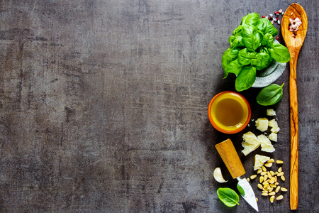 Flat lay of organic ingredients for italian pesto sauce on dark vintage background. Top view, copy space. Archivio Fotografico - 104978767