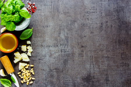 Italian pesto sauce ingredients on dark vintage background close up. Flat lay, top view, copy space. Archivio Fotografico - 105351887