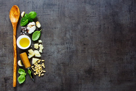 Flat lay of fresh ingredients for homemade italian pesto sauce on dark vintage background. Top view, copy space. Archivio Fotografico - 105435589