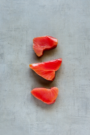 Raw Tuna fish steaks on light background. Healthy cooking. Food concept. Flat lay, top view
