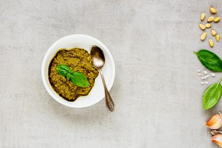 Italian basil pesto sauce and ingredients close up. Flat lay, top view. Archivio Fotografico - 109496662