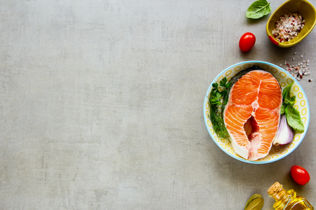 Cooking concept. Fresh salmon steak and ingredients for cooking flat-lay