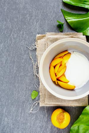 Breakfast flat lay. Healthy natural yogurt and fresh peach. Healthy food concept.