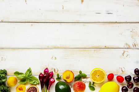 Fresh fruit, vegetables and greens flat lay. Summer food concept. Healthy life and vegetarian, vegan, dieting, clean eating ingredients Stock Photo