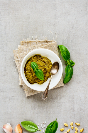 Italian basil pesto sauce and ingredients flat lay. Top view, copy space. Archivio Fotografico - 117286416