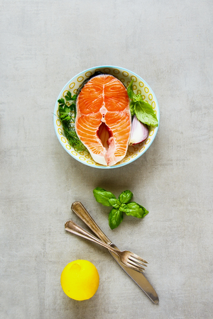 Fresh salmon steak and ingredients for cooking flat lay