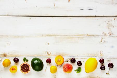 Seasonal fruit flat lay. Summer food concept. Healthy life and vegetarian, vegan, dieting, clean eating ingredients