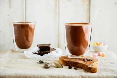 Composition with hot chocolate on light background. Warming sweet drink