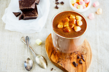 Hot chocolate and ingredients close up. Warming sweet drink Imagens