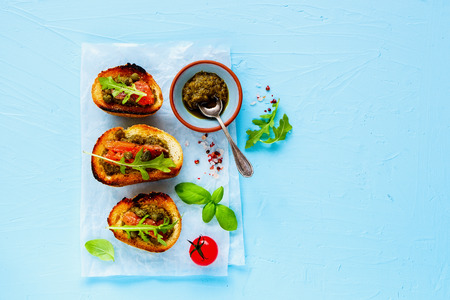 Homemade smoked salmon toasts on blue background flat lay Stock Photo