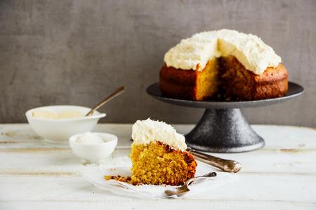 A slice of delicious coconut cake with mascarpone cream Stockfoto