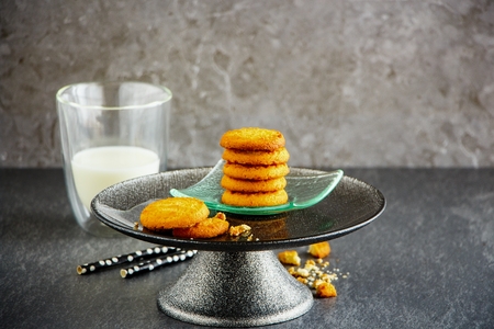 Tasty homemade butter cookies on cake stand and glass of milk - Image 写真素材