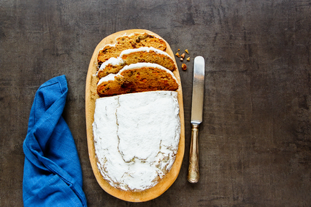 Flat-lay of homemade traditional stollen cake. Dresdner christ pastry top view Stock Photo