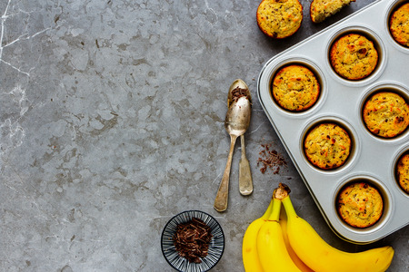 Flat-lay of banana chocolate muffins captured from above