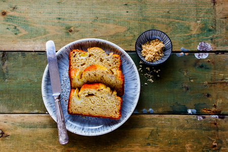 Flat-lay of sliced banana bread cake dessert in plate captured from above Imagens