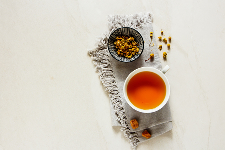 Chamomile tea in cup flat lay. Tea composition from above Stock Photo