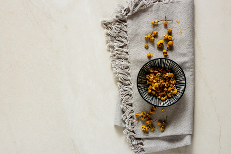 Flat-lay of Chamomile tea composition from above Stock Photo