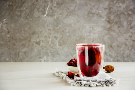 Hibiscus tea composition on grey background