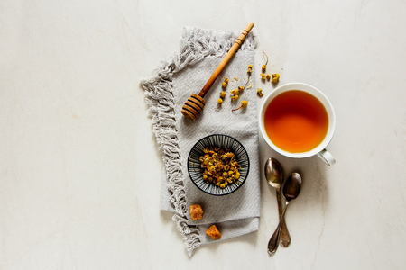 Healthy Chamomile tea in cup flat lay. Tea composition from above Stock Photo