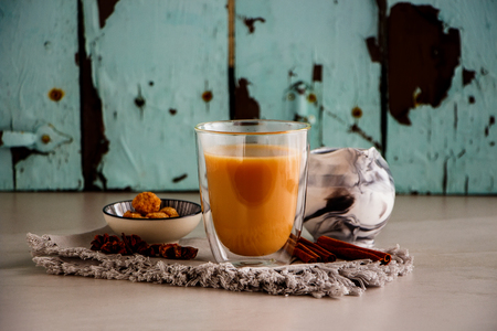 Homemade traditional indian masala chai tea in glass cup. Tea composition close up Stock Photo