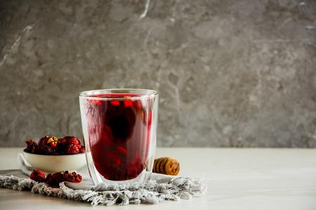 Hibiscus tea composition on grey background