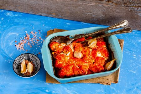 Baked salmon fish in baking dish close up